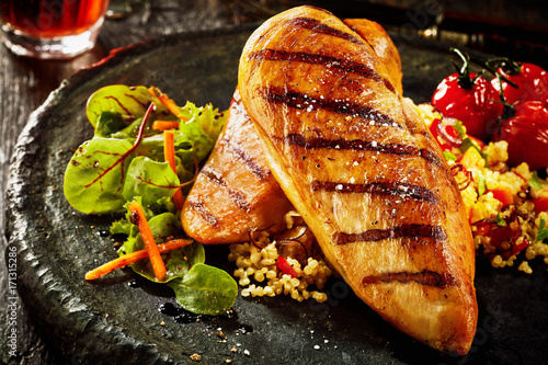 Photo Grilled chicken breast with couscous
