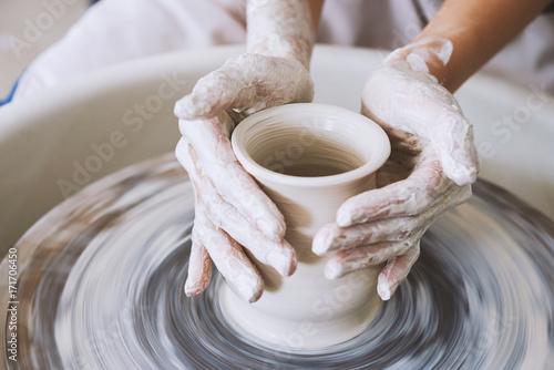 Working on pottery wheel Fototapeta