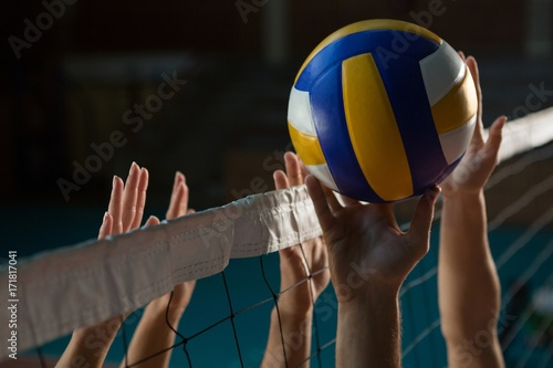 Cropped hands of players practicing volleyball