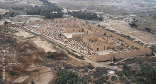 Stampa su Tela Restored ruins of the South palace of Nebuchadnezzar in ancient Babylon, Iraq on the right
