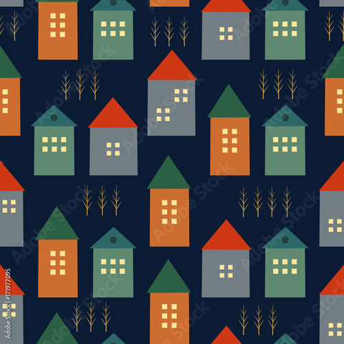 Cute houses and autumn trees seamless pattern on dark blue background. Scandinavian style illustration. Autumn landscape design for textile, wallpaper, fabric.