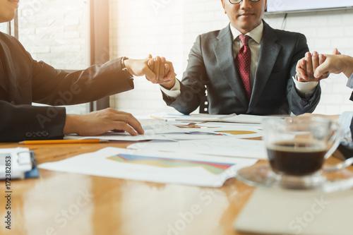 Business man team asking for blessings from God. Fototapeta