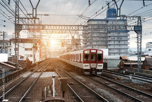 Carta da parati Japan train on railway with skyline at Osaka, Japan for transportation backgroun