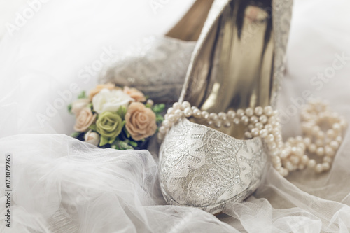 Fototapeta Arranged bridal shoes and accessories