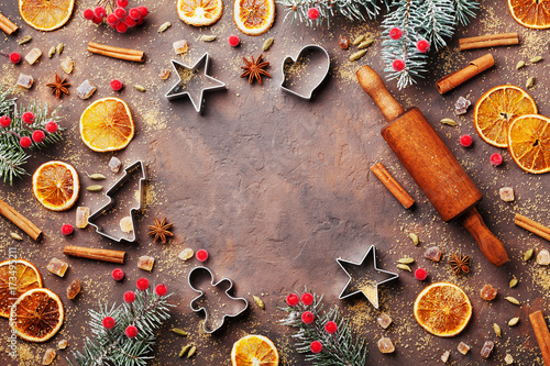 Tableau sur Toile Holiday food background for baking gingerbread cookies with cutters, rolling pin and spices on vintage table top view