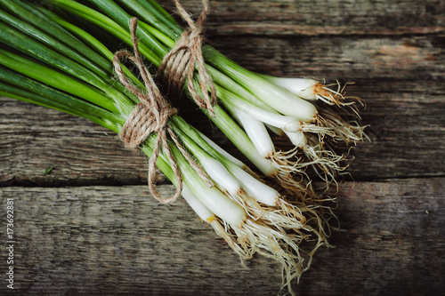spring onion Isolated on wooden background