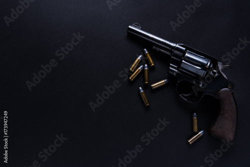 Canvas Print gun with bullets on black background
