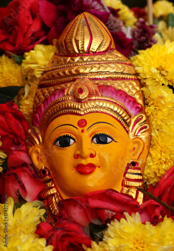 Hindu Goddess asta lakshmi idol on Flower arrangement called Bathukamma during Dussera celebrations