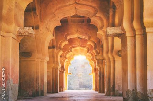 Old ruined arch of Lotus Mahal at sunset, Hampi, Karnataka, India.