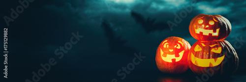 Fotografiet Three halloween Jack O' Lantern pumpkins