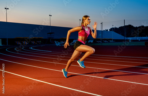 Canvas Print Runner sprinting towards success on run path running athletic track