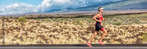 Running triathlon man athlete runner panoramic banner. Triathlete working out in tri suit. Sport athlete on marathon run training exercising cardio in professional outfit for triathlon.