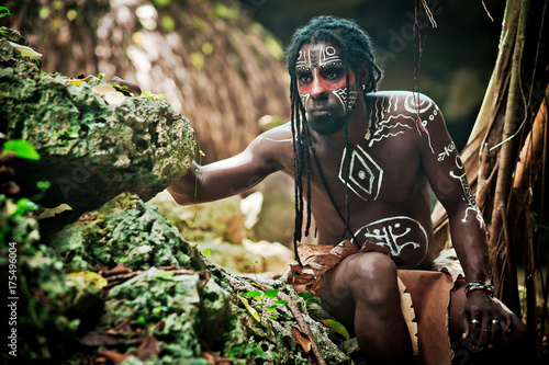 Wallpaper Mural Black man with dreadlocks in the image of the Taino Indian in habitat, body pain