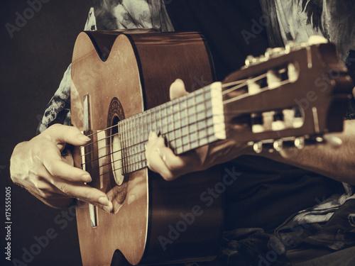 Closeup of man playing acoustic guitar Fototapeta