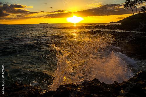 Ocean waves crashing on rocks at a tropical island beach