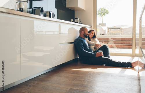 Loving young couple spending time together at home