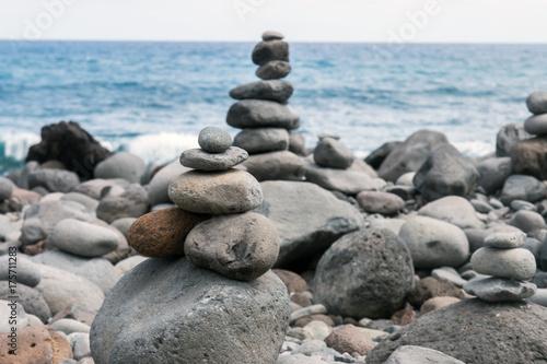 Balanced stones on beach