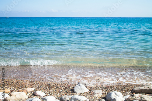 Waves on the seashore with the horizon in the background