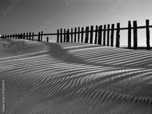 Sand dune against fences