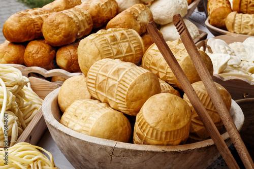 Many kinds of oscypek smoked cheese at market.