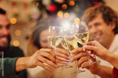 Fotografie, Obraz Group of friends celebrating Christmas at home