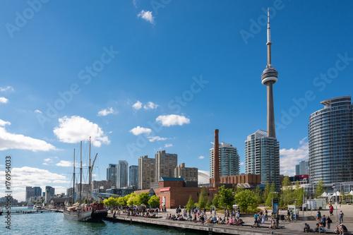 Canvas Print People enjoying beautiful sunny afternoon near lake Ontario in Toronto