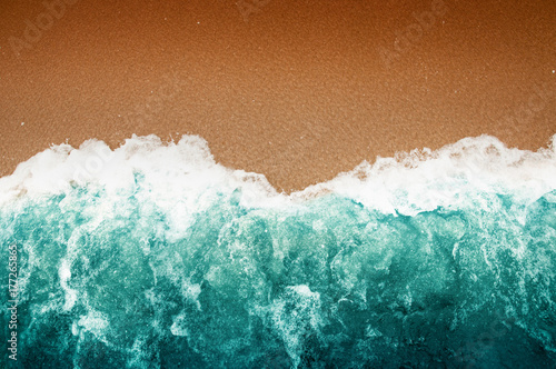Canvas Print Wave Of Teal Ocean On Sandy Beach