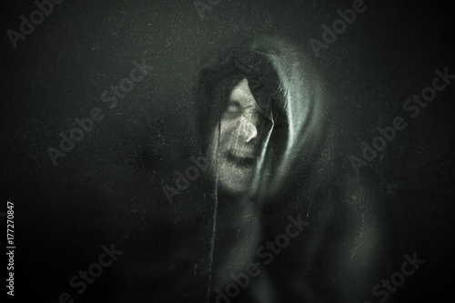 Fotografia Angry ghost figure in the dark