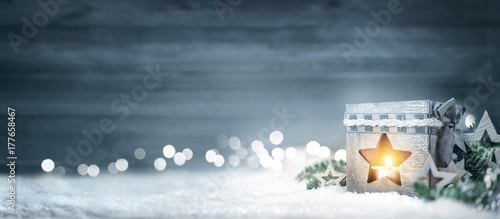 Christmas wood background with lantern, fir branches and lights