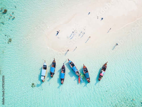 Stampa su Tela Top view or aerial view of longtail boats on crystal clear water along the sand
