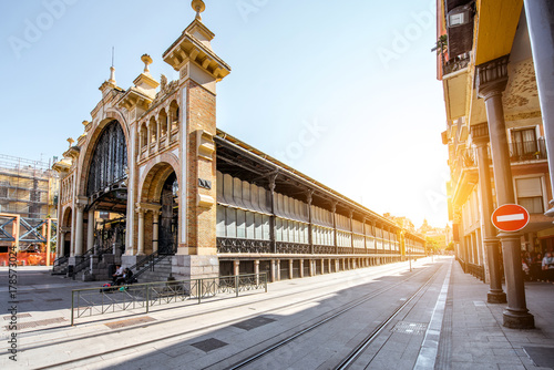 Street view with central food market building in Zaragoza city in Spain