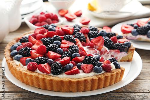 Obraz na płótnie Sweet tart with berries on grey wooden table