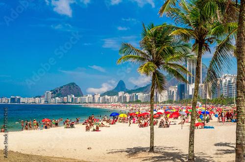 Copacabana beach (Praia de Copacabana) with palms in Rio de Janeiro. Brazil