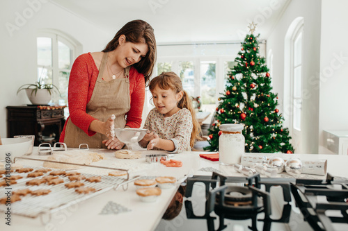 Mother and daughter making Christmas cookies.