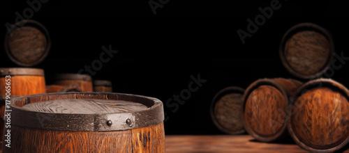 Fotografia Rustic wooden barrel on a night background