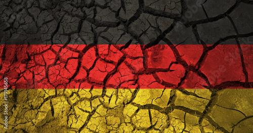 Wallpaper Mural german flag on cracked ground background