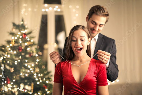 Fotografia, Obraz Sweet guy gifting a precious necklace to his beautiful girlfriend
