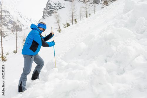 Billede på lærred Female rescuer searching for avalanche victim.