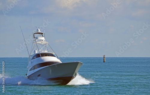 Fotografia, Obraz A luxury sport fishing boat returning from a day at sea.