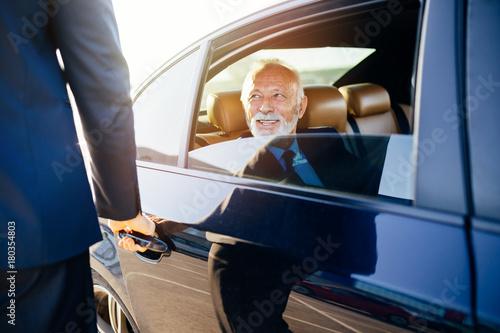 Stampa su Tela Senior business man sitting in his limousine