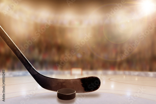Canvas Print Ice Hockey Stick and Puck in Rink With Copy Space