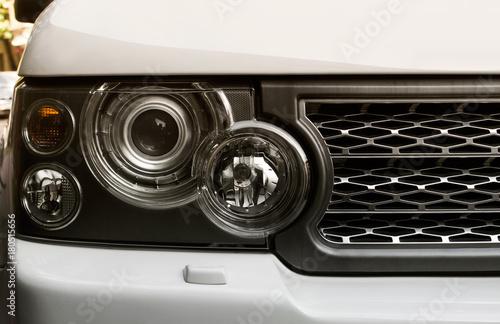 фотография Suv car headlight photo with mesh grille.