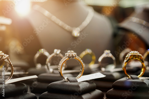 Fényképezés Jewelry diamond rings and necklaces show in luxury retail store window display