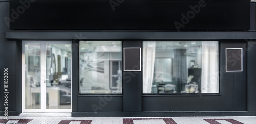 Wallpaper Mural Outdoor mock up,store template,front view black shop facade with windows display, three posters