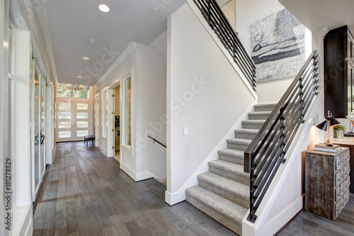 Hallway features a staircase with gray carpet runner Poster Mural XXL