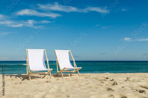 Photo Deck chairs on beach