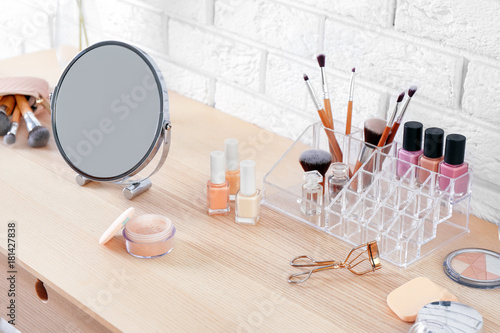 Obraz na plátně Cosmetic set with mirror on dressing table