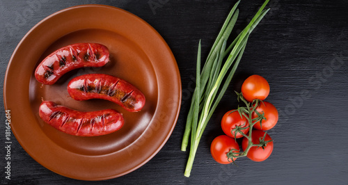 Fotografie, Obraz Round plate with toasted apetit sausages