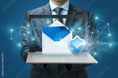 Businessman showing protected email on the computer.