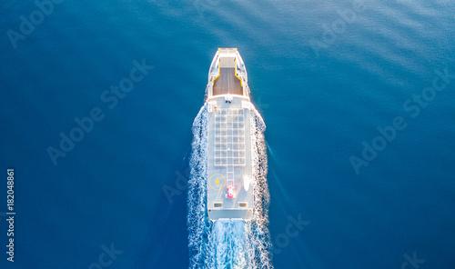Canvas Print CORFU, GREECE- NOVEMBER 24, 2017: A ferry of the Lefkimmi Lines in Corfu Greece crossing opposite Corfu island towards Greece mainland